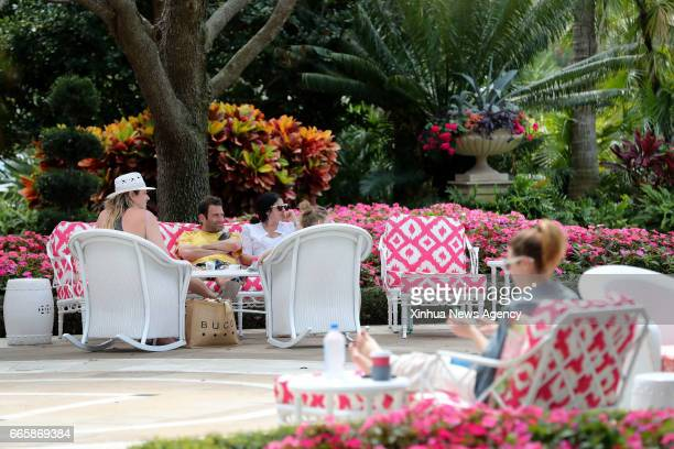 BEACH April 6 2017 People enjoy themselves at the Breakers a topnotch luxury hotel on Palm Beach Florida the United States March 24 2017 Stretching...