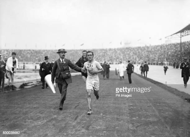 On this day in 1896 the first modern Olympics began in Athens Pictured here is the American athlete Johnny Hayes who is competing in the marathon...