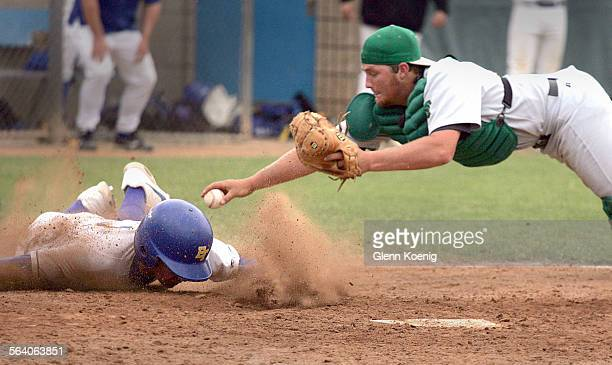 April 7 2007 El Toro's Kyle Ohlwiler scores the winning and game–ending run as Thousand Oaks catcher Chris Hannick was unable to make the tag during...