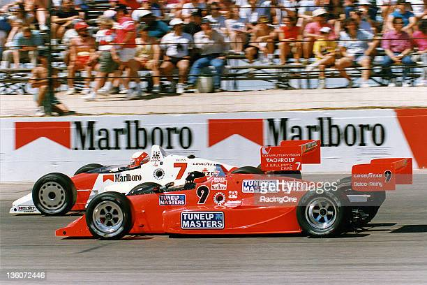 Danny Sullivan races with Didier Theys during the Autoworks 200 CART Indy Car race at Phoenix International Raceway Sullivan finished in sixth place...