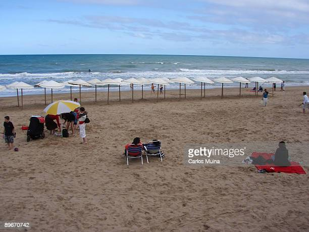 April 8 2007 Guardamar del Segura Alicante Spain In the image turists spending a day at the beach Playa Centro on Easter