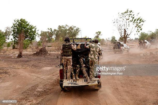 April 8- GWOZA, NIGERIA: Members of the Nigerian military patrol the streets of Gwoza, Boko Haram's base in northern Nigeria, recently retaken by the...