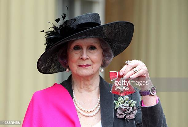 April Ashley holds her Member of the British Empire medal which was awarded to her by Queen Elizabeth II during an Investiture ceremony at Buckingham...