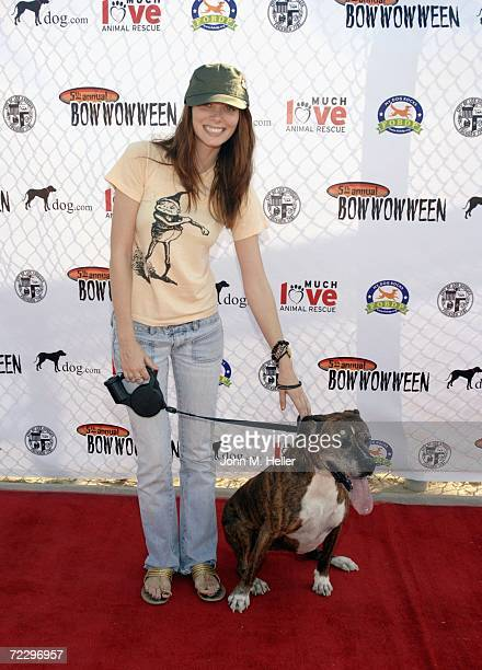 April Bowlby poses with her dog Sasha at the 5th Annual Bow Wow Ween at the Barrington Dog Park on October 29 2006 in West Los Angeles California