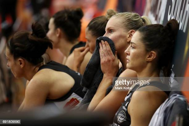 April Brandley and Sharni Layton of the Magpies look dejected after defeat during the Super Netball Major Semi Final match between the Giants and the...