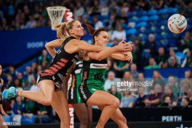 April Brandley of the Magpies competes for the ball with Natalie Medhurst of the Fever during the round two Super Netball match between the Fever and...