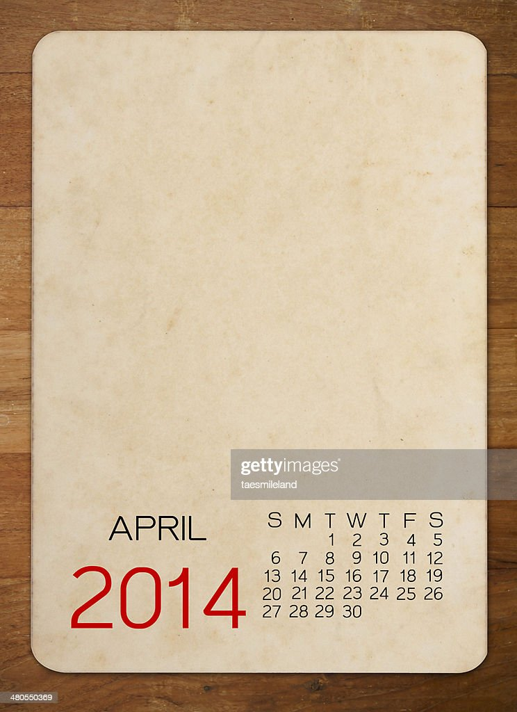 April Calendar 2014 on the Empty old photo on wood : Stock Photo