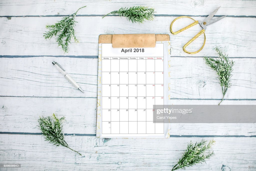 april calendar in clipboard with eucaliptus branches : Stock Photo