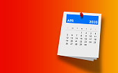 2020 April Calendar on Note Pad Against Colorful Background