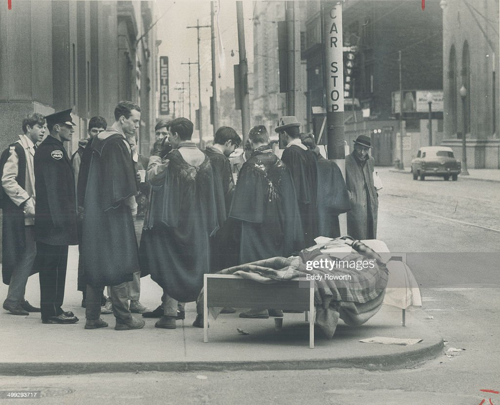 April Fool at King and Bay. King and Bay Sts. seems hardly the place for a nap on cool spring mornin... : News Photo