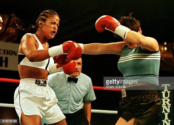 April Fowler of Michigan City Indiana staggers after being hit by Laila Ali of Los Angeles daughter of boxing great Muhammad Ali during the first...