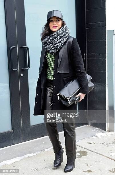 April Hennig is seen outside the Christian Siriano show wearing an Alexander Wang jacket a Kenzo sweater J Brand leather pants Proenza Schouler shoes...