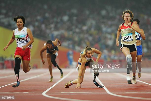 April Holmes of the United States and Marie-Amelie le Fur of France fall during the final of the Women's 200M - T44 Athletics event at the National...