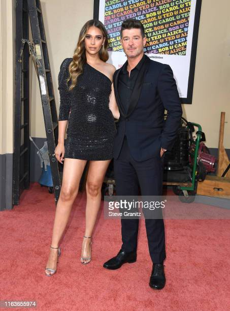"""April Love Geary and Robin Thicke arrives at the Sony Pictures' """"Once Upon A Time...In Hollywood"""" Los Angeles Premiere on July 22, 2019 in Hollywood,..."""
