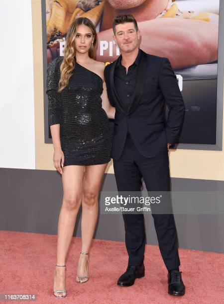 April Love Geary and Robin Thicke attend Sony Pictures' Once Upon a Time in Hollywood Los Angeles Premiere on July 22 2019 in Hollywood California