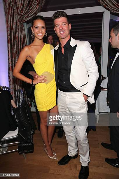 April Love Geary and Robin Thicke attend the De Grisogono party during the 68th annual Cannes Film Festival on May 19 2015 in Cap d'Antibes France