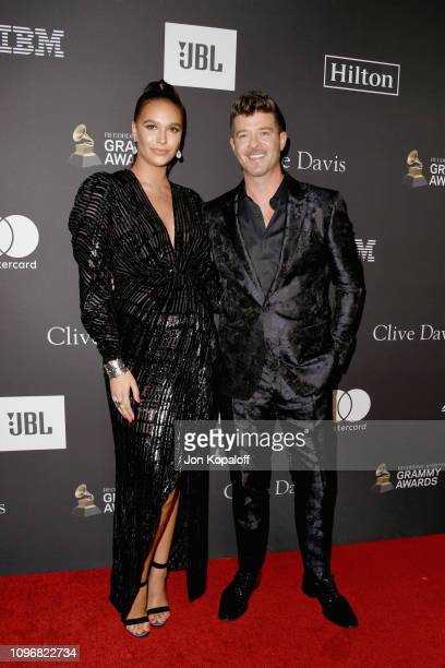 April Love Geary and Robin Thicke attend The Recording Academy And Clive Davis' 2019 PreGRAMMY Gala at The Beverly Hilton Hotel on February 9 2019 in...