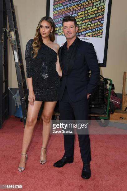 """April Love Geary and Robin Thicke attend the Sony Pictures' """"Once Upon A Time...In Hollywood"""" Los Angeles Premiere on July 22, 2019 in Hollywood,..."""
