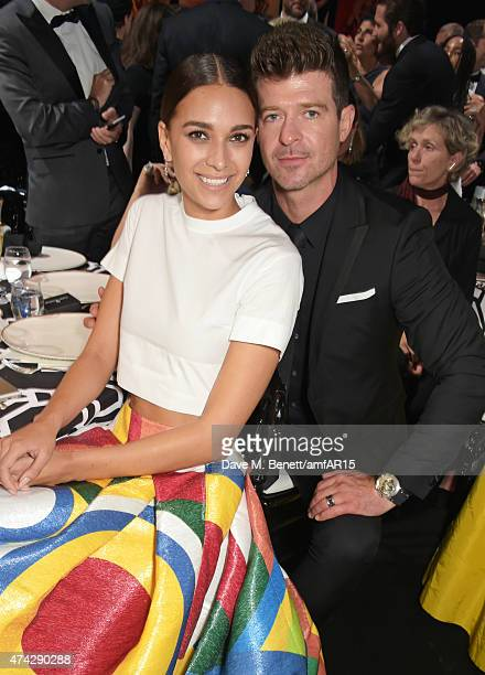 April Love Geary and singer Robin Thicke attend amfAR's 22nd Cinema Against AIDS Gala Presented By Bold Films And Harry Winston at Hotel du...