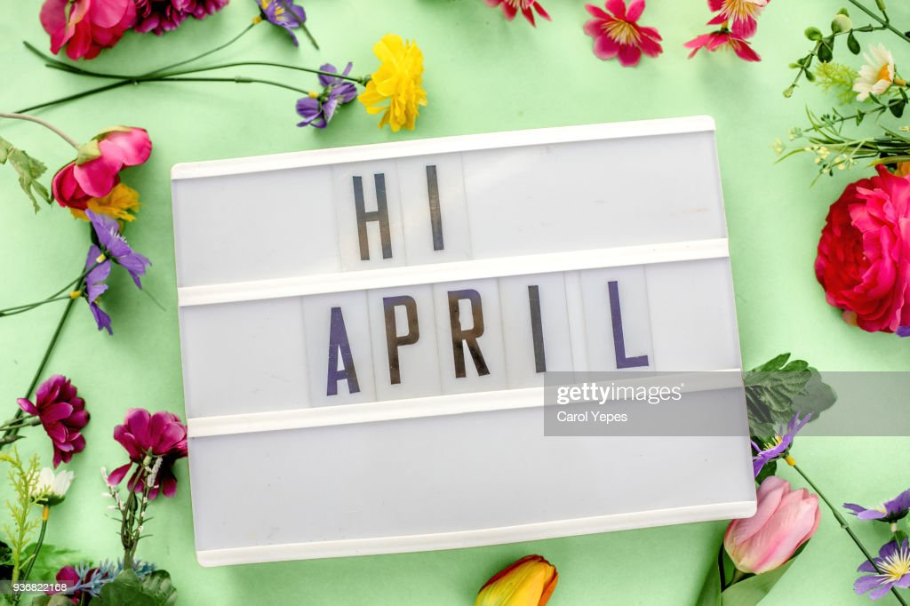 april message in lightbox. Floral and gren bacground : Stock Photo