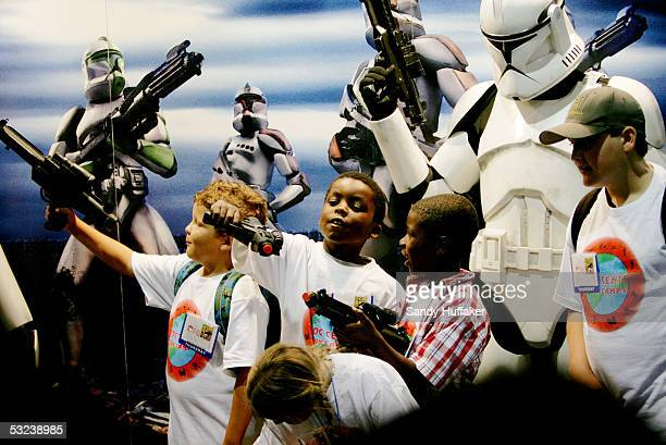 April Page and Stephanie Manuel pose with 'Star Wars' Storm Troopers at Comic Con International July 14 2005 in San Diego California Comic Con is the...