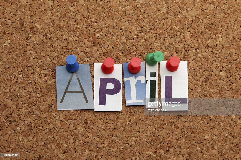 April pinned on noticeboard : Stock Photo