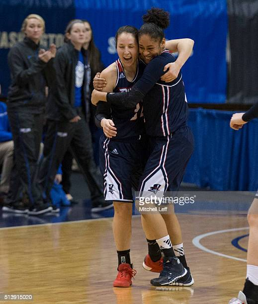 April Robinson and Deva'Nyar Workman of the Duquesne Lady Dukes hug after the game against the Saint Louis Billikens in the Semifinals of the women's...