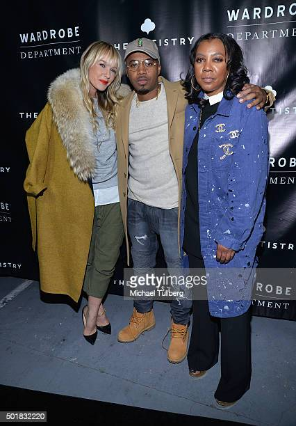 April Roomet hiphop artist Nas and Arell Hughes attend the grand opening of the Wardrobe Department LA store at Wardrobe Department on December 17...