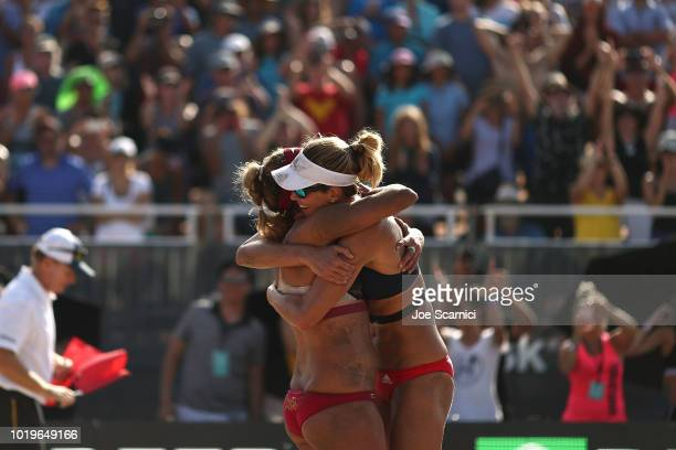 April Ross and Alix Klineman celebrate championship point after beating Brittany Hochevar and Kelly Claes at the AVP Manhattan Beach Open on August...
