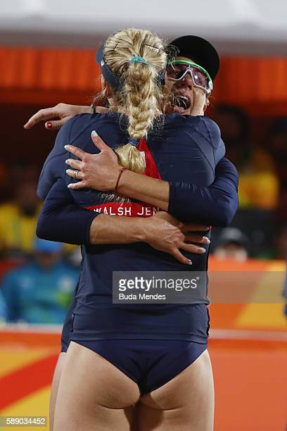 April Ross and Kerri Walsh Jennings of the United States celebrate victory in the Women's Round of 16 match against Marta Menegatti and Laura...