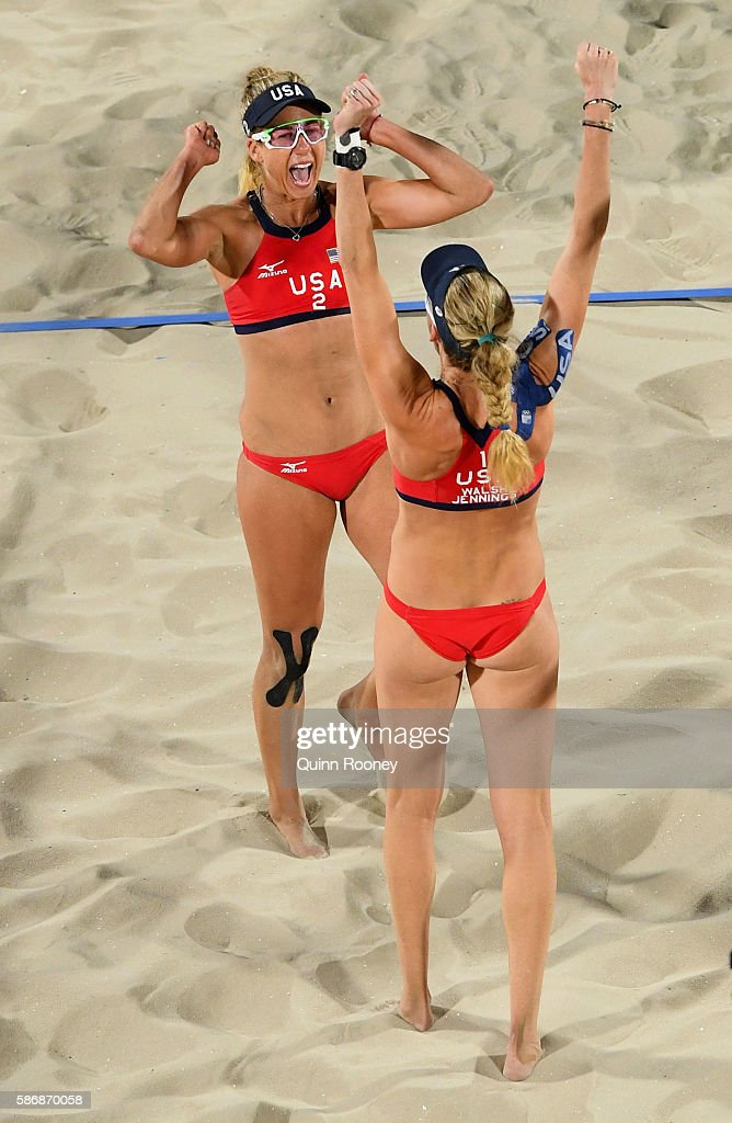April Ross (2) and Kerri Walsh Jennings of the United States victory after the Women's Beach Volleyball preliminary round Pool C match against Mariafe Artacho del Solar and Nicole Laird of Australia on Day 1 of the Rio 2016 Olympic Games at the Beach Volleyball Arena on August 6, 2016 in Rio de Janeiro, Brazil.