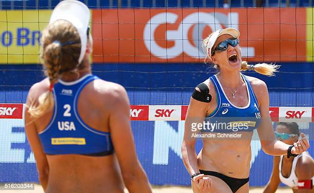 April Ross and Kerri Walsh of the United States celebrates their victory after winning the main draw match against Brazil during the main draw match...