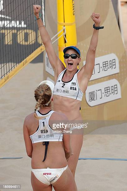 April Ross and Kerri Walsh of United States celebrate win the 2013 FIVB World Tour Xiamen Grand Slam Women's Final match against Taiana Lima and...