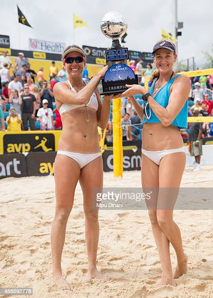 April Ross and Kerri WalshJennings hoist the championship trophy at the 2014 AVP Cincinnati Open on August 31 2014 at the Lindner Family Tennis...