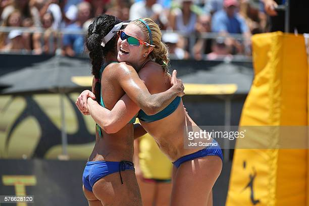 April Ross and Lane Carico celebrate a point during their quarter final match against Geena Urango and Angela Bensend at AVP Beach Volleyball...