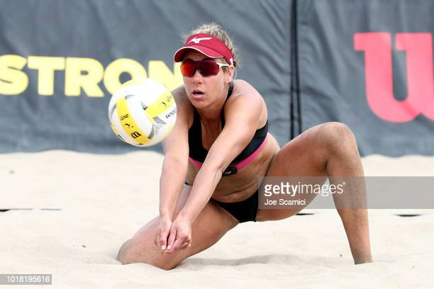 April Ross digs the ball during her round of 32 match against Annika and Teegan Van Gunst AVP Manhattan Beach Open on August 17 2018 in Manhattan...