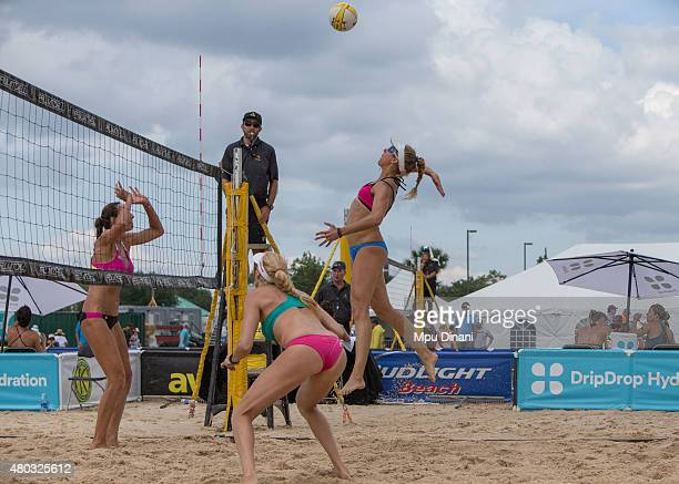 April Ross jumps to spike against Jenny Kropp as Kerri WalshJennings looks on at the AVP New Orleans Open at Laketown on May 23 2015 in Kenner...