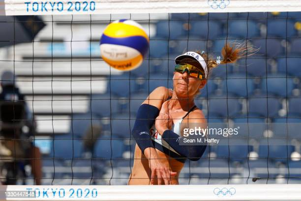April Ross of Team United States looks on after a hit against Team China during the Women's Preliminary - Pool B on day two of the Tokyo 2020 Olympic...