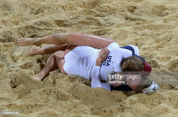 April Ross of the United States and Jennifer Kessy of the United States celebrate after winning match point during the Women's Beach Volleyball Semi...