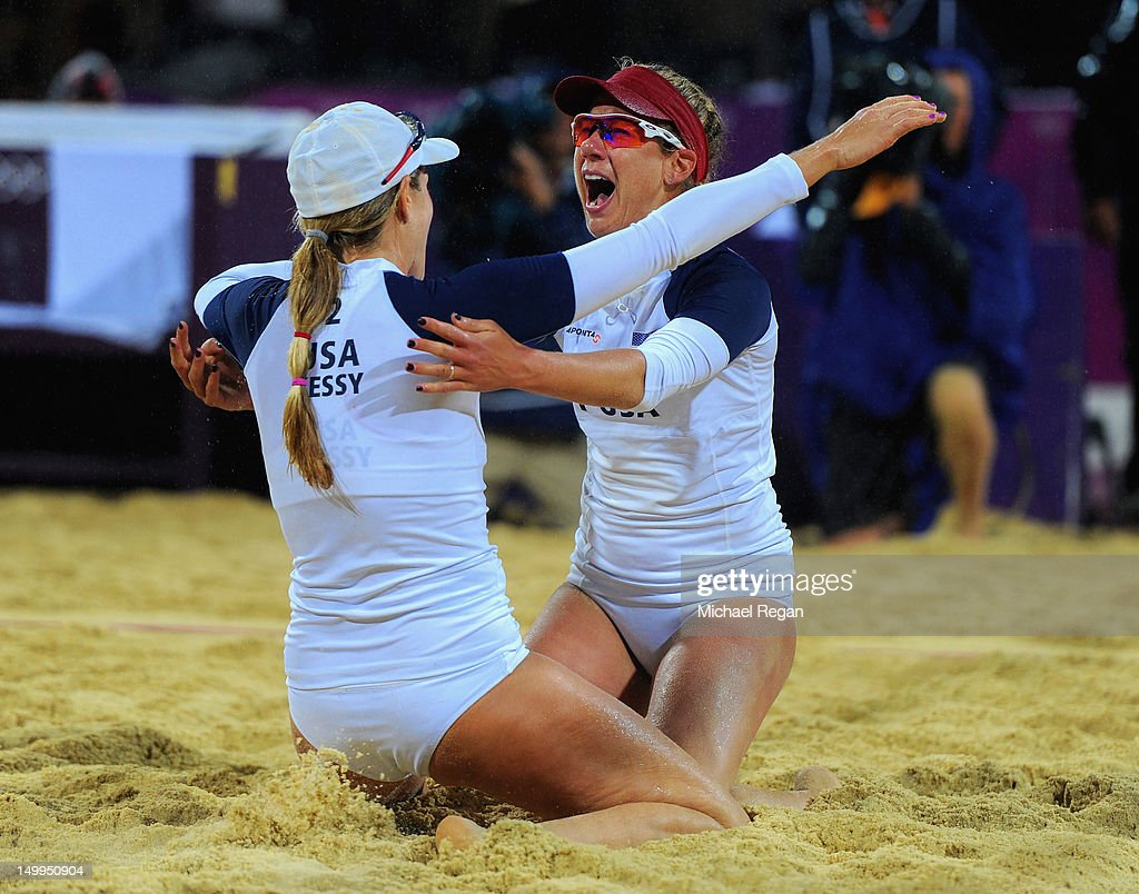 April Ross (R) of the United States and Jennifer Kessy of the United States celebrate after winning match point during the Women's Beach Volleyball Semi Final match between United States and Brazil on Day 11 of the London 2012 Olympic Games at Horse Guards Parade August 7, 2012 in London, England.
