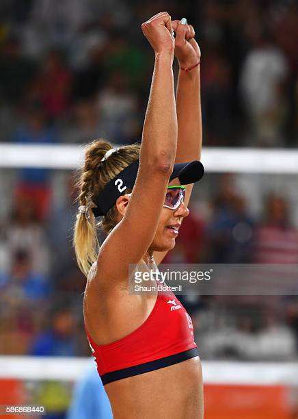 April Ross of the United States celebrates victory after the Women's Beach Volleyball preliminary round Pool C match against Mariafe Artacho del...