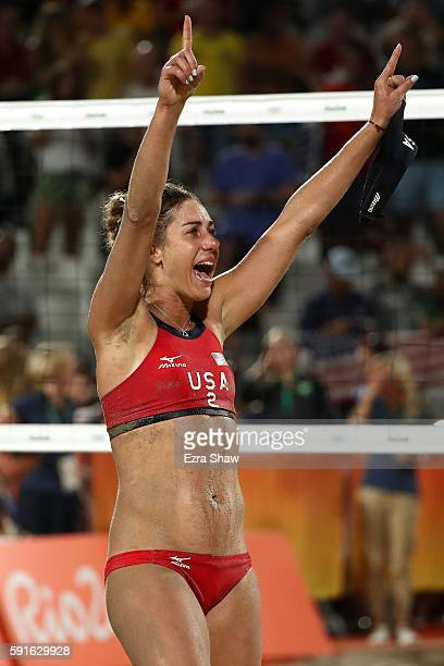 April Ross of the United States celebrates winning match point during the Beach Volleyball Women's Bronze medal match against Larissa Franca...