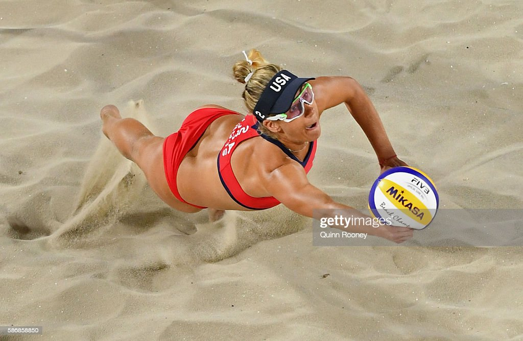 April Ross of the United States dives for the ball during the Women's Beach Volleyball preliminary round Pool C match against Mariafe Artacho del Solar and Nicole Laird of Australia on Day 1 of the Rio 2016 Olympic Games at the Beach Volleyball Arena on August 6, 2016 in Rio de Janeiro, Brazil.