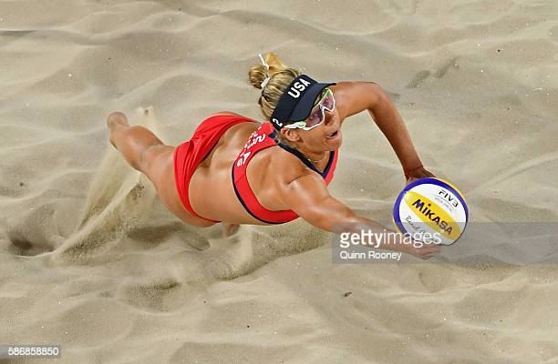 April Ross of the United States dives for the ball during the Women's Beach Volleyball preliminary round Pool C match against Mariafe Artacho del...