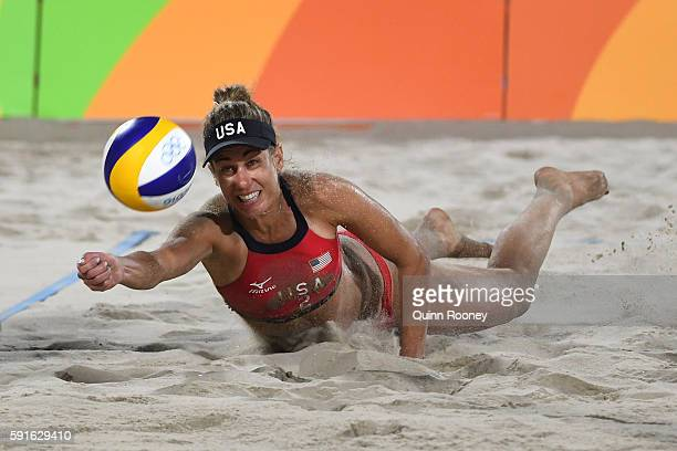 April Ross of the United States plays a shot during the Beach Volleyball Women's Bronze medal match against Larissa Franca Maestrini and Talita Rocha...