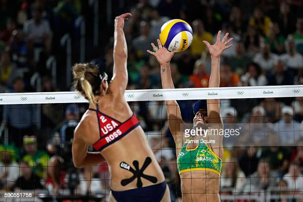 April Ross of the United States spikes during the beach volleyball Women's Semi final against Agatha Bednarczuk Rippel of Brazil on Day 11 of the Rio...