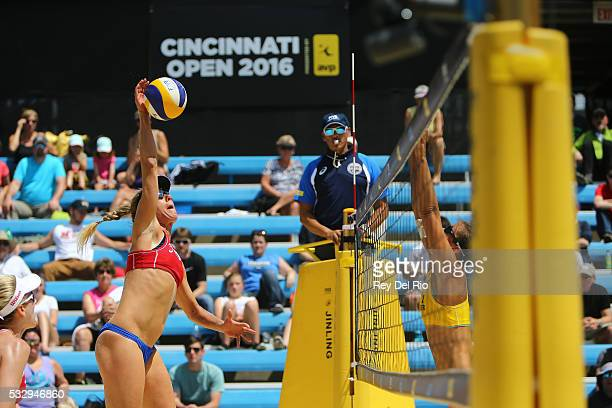 April Ross of the USA hits the ball over the net during her match against Isabel Schneider and Teresa Mersmann of Germany during day 3 of the 2016...