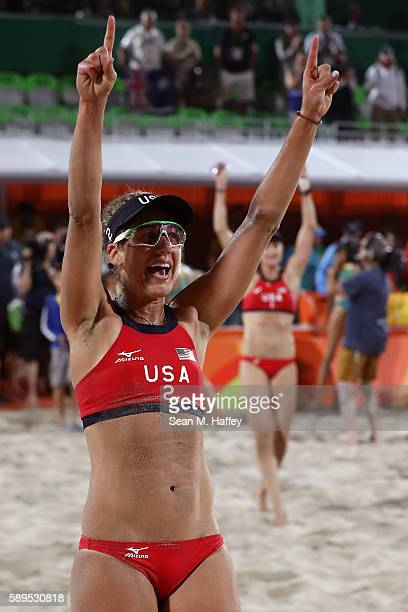 April Ross of United States and teammate Kerri Walsh Jennings celebrate after defeating Australia in a Women's Quarterfinal match on Day 9 of the Rio...