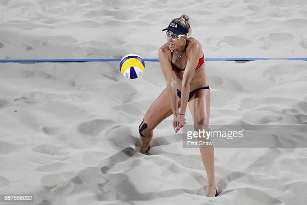 April Ross of United States bumps the ball during the Women's Beach Volleyball preliminary round Pool C match against Fan Wang and Yuan Yue of China...