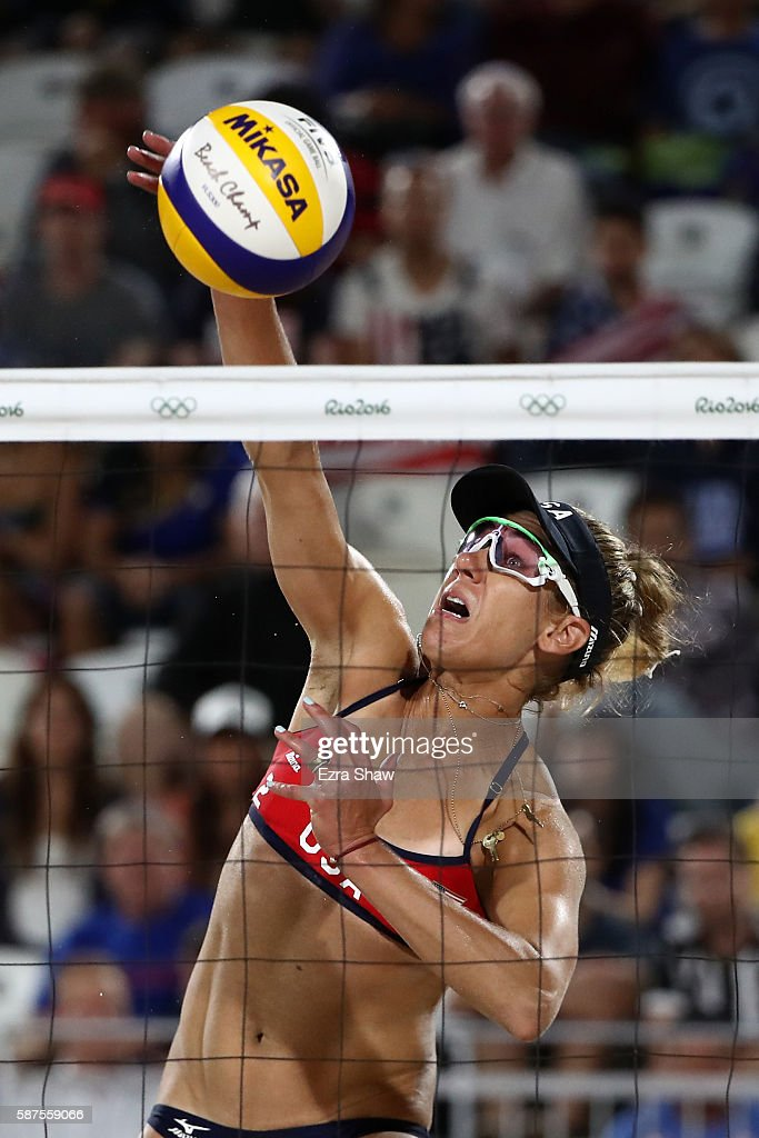 April Ross of United States bumps the ball during the Women's Beach Volleyball preliminary round Pool C match against Fan Wang and Yuan Yue of China on Day 3 of the Rio 2016 Olympic Games at the Beach Volleyball Arena on August 8, 2016 in Rio de Janeiro, Brazil.